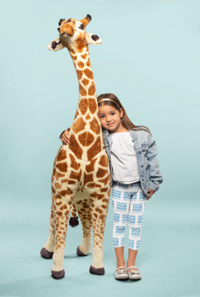 Leggings Mockup of a Cute Little Girl Hugging a Plush Giraffe 23909