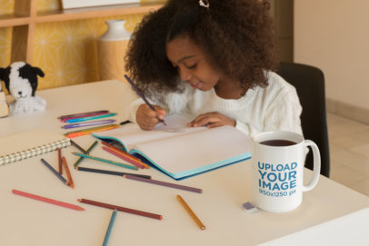 Mug Mockup of a Beautiful Little Girl Coloring Her Book 23905