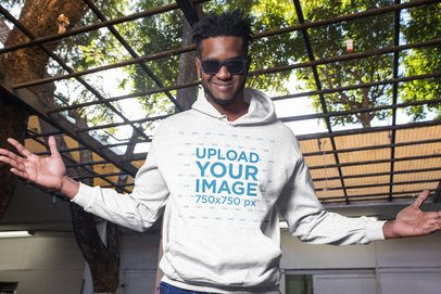 Mockup of a Man Showing of His Pullover Hoodie 24312