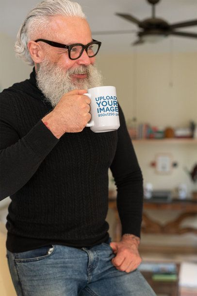 Mockup of a Hipster Man Holding a Coffee Mug at his House 23990