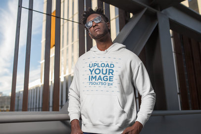 Pullover Hoodie Mockup of a Man Looking at the Sun in the City 24315