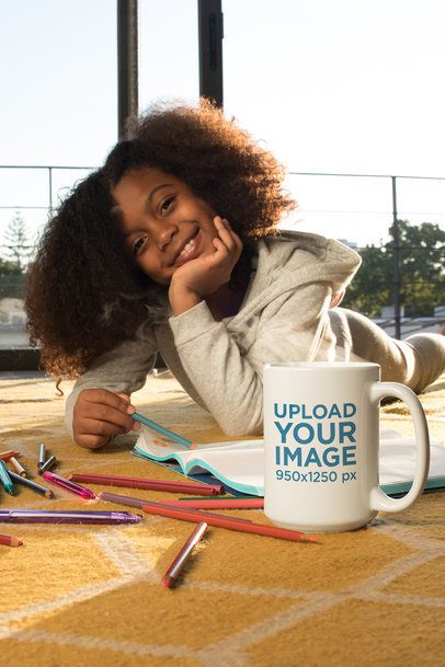 Coffee Mug Mockup of a Happy Girl Drawing While Lying on the Floor 24010