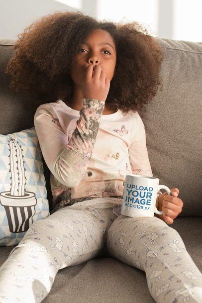 Mug Mockup of a Little Girl Sitting on a Couch 24012