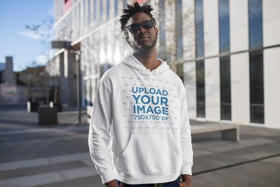 Hoodie Mockup Featuring a Man Outside a City Building 24317