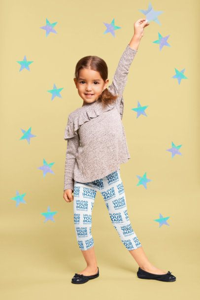 Mockup of a Child Wearing Leggings Holding a Shiny Star 23917