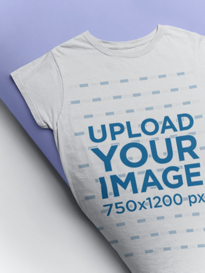 Mockup of a Tee Rolling into a Backdrop Paper Roll 24350