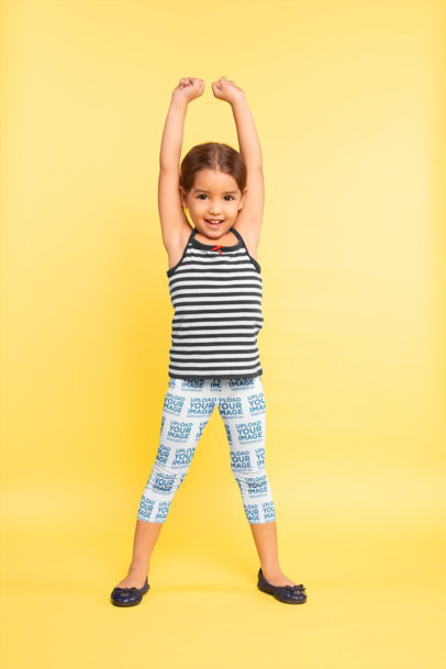Mockup of a Little Girl Wearing Leggings while Stretching 23923