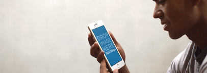 Mockup of a Young Man Holding an iPhone 6 Over a White Background a4909