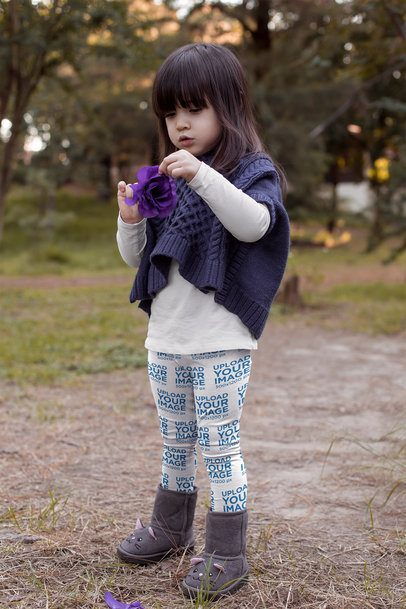Mockup of a Cute Child Wearing Leggings and Looking at a Flower 23934