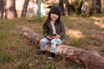 Mockup of a Girl Wearing Leggings Holding Pinecones in Her Hand 23928