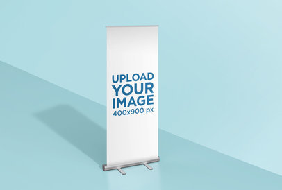 Mockup of a Roll-Up Banner Standing in a Colored Room 24508