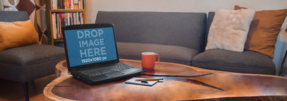 Mockup of a Black Laptop On Top of a Wooden Coffee Table a4915