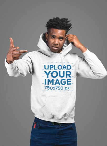 Mockup of a Chill Man Wearing a Pullover Hoodie in a Studio 24332