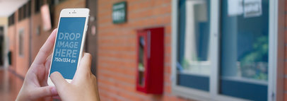 Mockup of a Female Student Using an iPhone 6 at School a5044