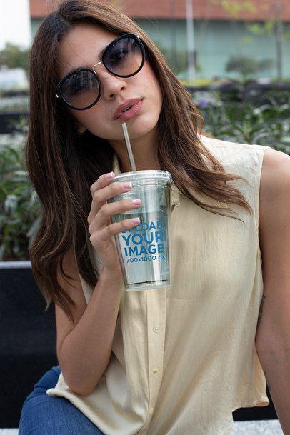 Tumbler Mockup of a Woman Wearing Sunglasses 24413