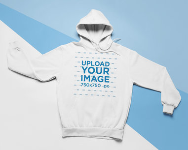 Flat Lay Mockup of a Pullover Hoodie on a Tricolor Background 24568