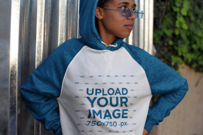 Raglan Hoodie Mockup Featuring a Girl with Glasses Looking Away 24151