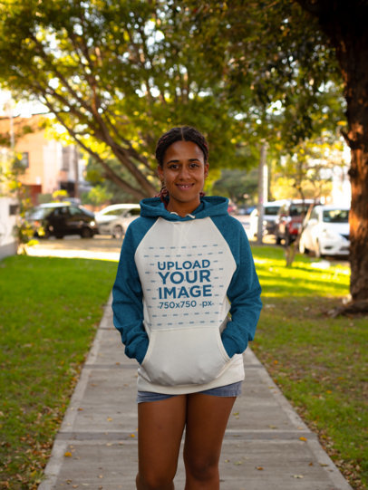 Raglan Hoodie Mockup of a Smiling Girl at a Park 24157