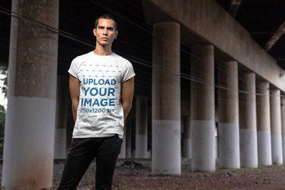 T-Shirt Mockup of a Serious Man Standing Under an Overpass Bridge 24533