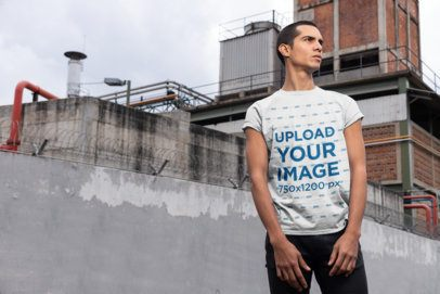 Mockup of a Man Wearing a Tee and Standing in an Industrial Scenario 24523