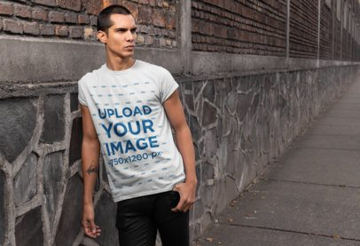 Tee Mockup Featuring a Cool Man With a Forearm Tattoo 24525