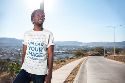 T-Shirt Mockup of a Smiling Man with Locs Out on a Sunny Day 20023