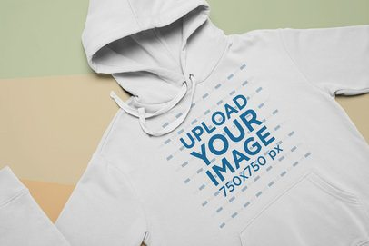 Flat Lay Mockup Featuring a Hoodie Over Pasteboards 24543