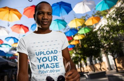 Tee Mockup Featuring a Man Surrounded by Hanging Umbrella Decorations 24069