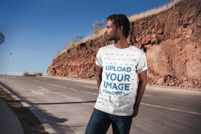 Mockup of a Man Wearing a Tee on a Highway 20024