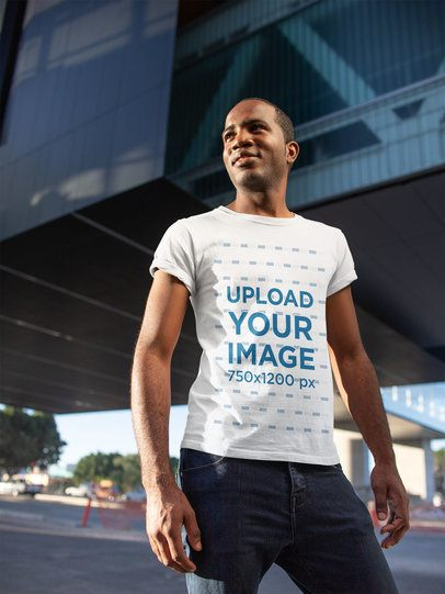 Tee Mockup of a Happy Man Standing Confidently in Front of a Building 24076