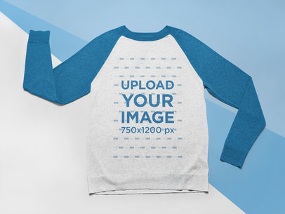 Mockup of a Raglan Crewneck Sweatshirt Laid Flat on a Tricolor Surface 24576