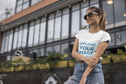 Tee Mockup of a Smiling Woman in the City Wearing Trendy Sunglasses 24639