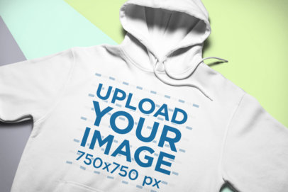 Mockup of a Hoodie Lying over Colorful Pasteboards 24538