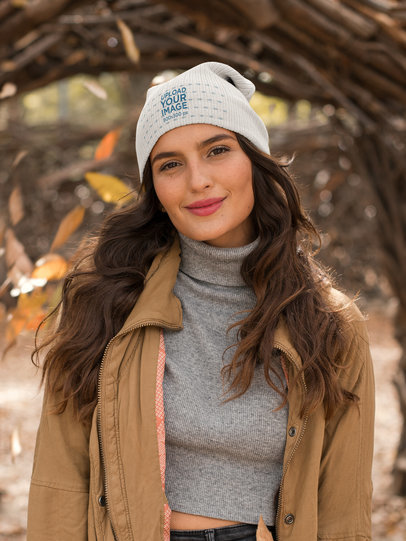 Mockup of a Smirking Woman Wearing a Beanie and a Cropped Sweater 24604
