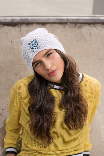 Beanie Mockup Featuring a Young Woman Wearing a Yellow Sweater 24614