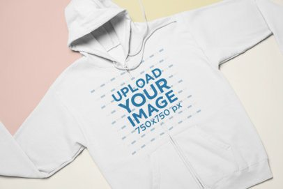 Mockup of a Zip-Up Hoodie Laid Flat on a Tricolor Custom Surface 24732
