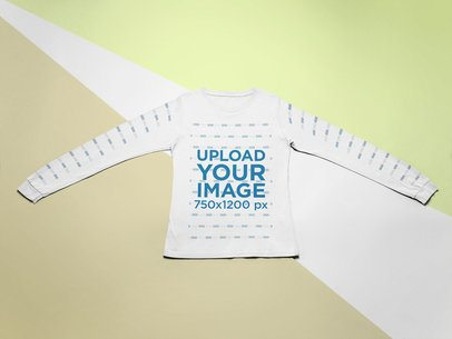 Mockup of a Long Sleeve Tee Laid Flat on a Surface with Three Colors 24579