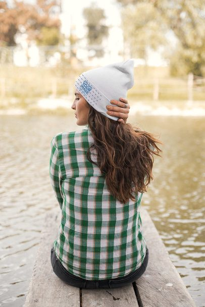 Beanie Mockup of a Woman Sitting by a Lake 24626