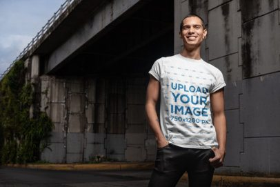 Mockup of a Smiling Man Wearing a Tee Under a Bridge 24536