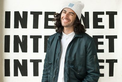 Mockup of a Man Wearing a Knit Beanie and Winking 24634