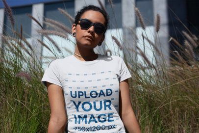 T-Shirt Mockup of a Woman with Sunglasses Looking Seriously at the Camera 18247