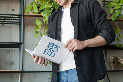 Notebook Mockup Featuring a Man with a Black Shirt  24180