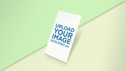Mockup of a Vertical Business Card on a Surface with Two Colors 25043