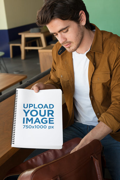 Mockup of a Man Taking a School Notebook from His Bag 24159