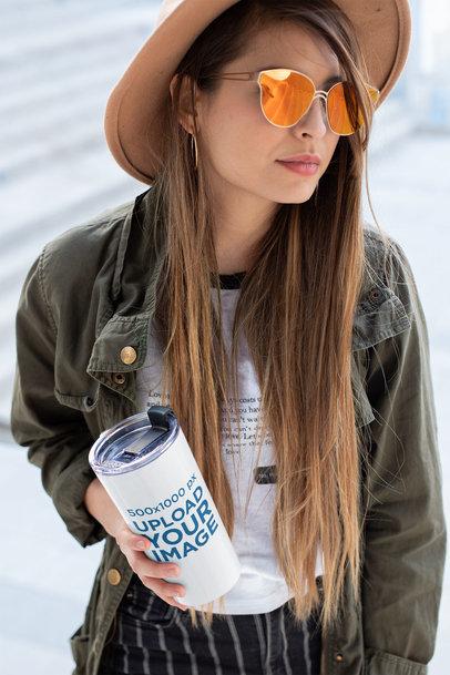 Mockup of a Fashionable Girl Holding a Travel Mug 24335