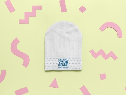 Mockup of a Beanie with Cut Out Paper Shapes 24952