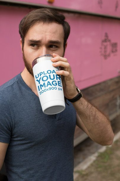 Mockup of a Handsome Man Drinking from His Travel Mug 24393