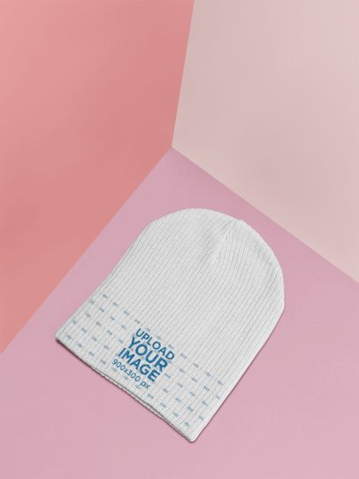 Mockup of a Knit Beanie Lying on a Colored Surface 25182