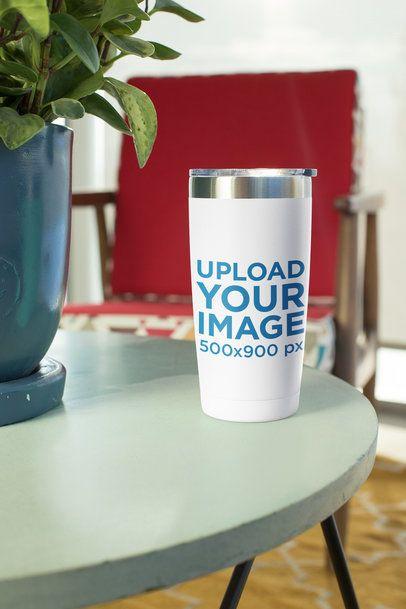 Mockup of a Travel Mug Standing on an End Table 24449
