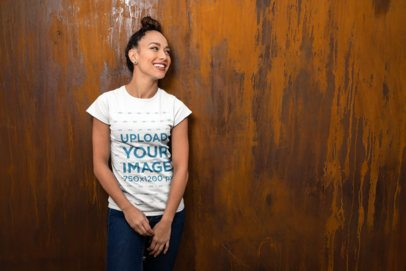 Mockup of a Happy Woman with a Bun Wearing a T-Shirt 24665
